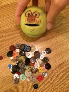 Tennis ball with smaller slit. More difficult to squeeze than larger slit. Small buttons. Can work on grip strength, bilateral coordination, in hand manipulation, fine motor coordination.