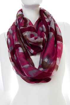 """Infinity scarves will never go out of style. This multi-colored scarf is a mix of different shades of burgundy and grey. """"Lakeya"""" could be worn with a simple tee during the summer, or even a bulky sweater during the winter! #scottsmarketplace"""