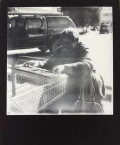 Marilyn | Portrait Of A Street Performer | Photo By Teddy | Polaroid SX-70 | Impossible SX-70 B&W Film - Black Frame (Expired) | ND Filter | Focus: Auto | Light/Dark: Centered | Flash: No | Tripod: No | Conditions: 22C, Backlit Bright Sunlight, Light Reflecting Off The Lens And Affecting The Image | Polaroid | Impossible Project | Mint Camera | Street Photography