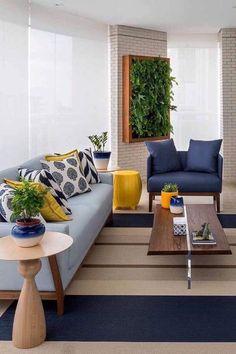 Varanda decorada com sofá azul claro e poltrona em azul petróleo; o amarelo, cor complementar ao azul, entra na decor para criar contraste Living Room Sofa, Home Living Room, Living Room Designs, Living Room Decor, Centre Table Living Room, Bedroom Decor, Room Colors, Sofa Set, Sofa Design