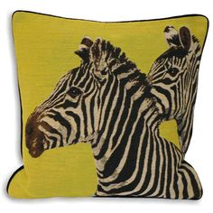 As a more modern and unexpected twist on animal print, why not add a portrait of a zebra or two onto your sofa? We love the combination of lime green, black and white in this Twin Zebra Cushion, £19.95 from Dwell. Mix and match your cushion designs for a more eclectic feel.