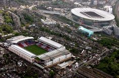 Arsenal's Highbury and Emirates Stadiums sit side by side shortly before the former was demolished in 2006/7