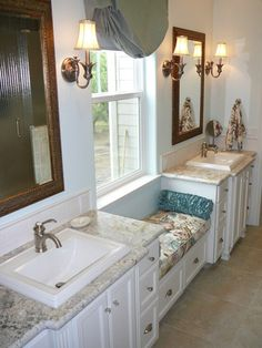 Master bathroom his-and-hers vanities with window seat.