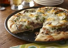 I found this recipe for Philly Cheese Steak Pizza, on Breadworld.com. You've got to check it out!