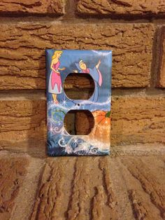 Cinderella and Fairy Godmother electrical outlet socket cover. The photo came from a Disney Cinderella book. The switch plate was made with