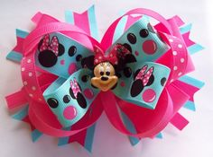 Several minnie bows including this Pink And Blue Inspired Minnie Mouse Hair by JustinesBoutiqueBows, $8.00 shara_reilly