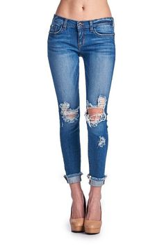 Medium wash jeans with distressed knees and cuffed, frayed hem. Jeans are junior-sized so recommend sizing up. If you're a 6, order a 7. If you're a 8, order a 9 and so on.