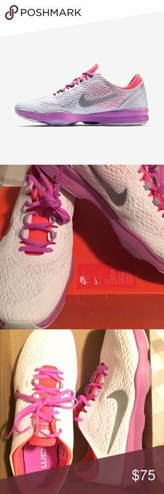 Nike Zoom Women's shoes The Nike Zoom Fit White/Fuchsia Glow/Hot Lava/Metallic Silver for Women's Nike Training Shoes are designed with a lightweight sandwich mesh upper and nylon webbing underneath for dynamic lockdown and breathability. Nike Shoes Sneakers