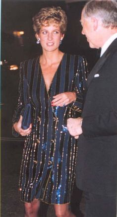 Diana visiting her ancestral home, Spencer House as a guest of honor marking the 70th birthday of Henry Kissenger wearing Catherine Walker designed, double-breasted evening coatdress in Corisia wool pinstripe with re-embroidered deep blue sequins and sapphire paste buttons.