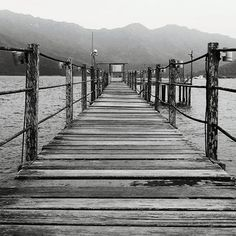 black and white photography  | perspective | lines | sea | mountain Line Photography, Black And White Photography, Railroad Tracks, Perspective, Mountain, Sea, Black White Photography, Perspective Photography, The Ocean