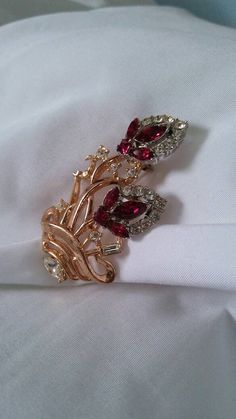 Check out this item in my Etsy shop https://www.etsy.com/listing/501054771/trifari-pat-pending-ruby-rhinestone