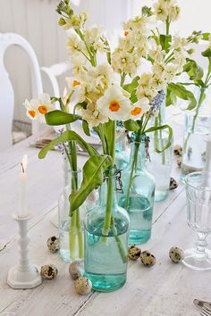 Spring Flowers in Vintage Blue colored bottles.  ~ Mary Wald's Place - VIBEKE DESIGN