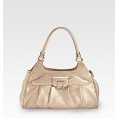 Loving the color of this Salvatore ferragamo purse