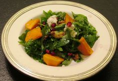 Persimmon Salad with arugula, baby kale, sweet and salty walnuts, and pomegranit seeds - dressed with olive oil, walnut oil, and a splash of a white sweet vinegar. Made it mulitple times during the holidays - a hit every time.