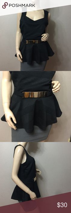 💗NWOT BLACK PEPLUM TOP WITH GOLDEN BELT💗 Beautiful peplum top with decorative metal plate in the front, style with skinny jeans and sleek accessories for that every day look or with a midi skirt for that instant sass! 96% polyester 4% spandex. Fashion magazine Tops Blouses