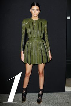 Balmain is known for its classic, French-military inspired bodycon dresses and power shoulders, which Kendall Jenner—a friend of designer Olivier Rousting—shows off to perfection.   - HarpersBAZAAR.com