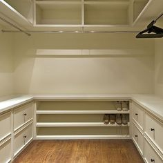 Functional closet design with drawers, a shoe rack, and storage above. Love this idea to use all the space in the closet.
