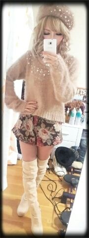 Cool gyaru: Beige beret with stones. Beige, knit, fuzzy shirt with stone details. Black skirt with flower pattern. White thigh-high boots.