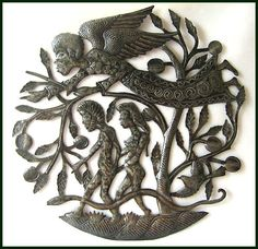 Adam and Eve are being watched over by an angel. Hand cut from recycled steel drums.Handcrafted in our own workshop in Haiti. Haitian metal art wall hanging measures 24 inches.  - www.HaitiMetalArt.com