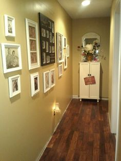 Picture Gallery-- All frames were sprayed ivory which look great with the black accent frame in the middle.