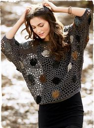 Dimensional blooms are caught in an earthy fishnet web. The freeform pullover is entirely handcrocheted of baby alpaca (84%), merino wool (8...