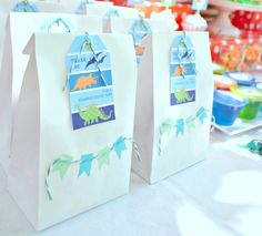 dinosaur birthday party {printables by Anders Ruff}: favor bags with washi tape mini banners