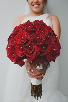 Bridal bouquet: love this red rose bouquet with pearl pin accents #wedding