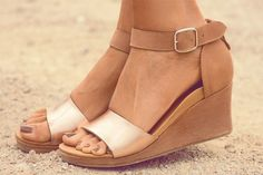 For a neutral wedge with a bit of sparkle you can't go wrong. Rose Gold complements all skin tones and will go with everything from jeans to dresses with ease.  Lovebird wedge heel by Bared Footwear.