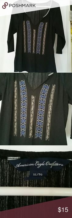 🐰 SALE! AEO Boho style TOP Was$14, NOW$10.  Awesome American Eagle black top w/boho style pattern on the front. Lightweight and flowy very easy top to wear and goes great with jeans a skirt or whatever! This is in GUC and lightly worn. Very comfy, crinkly material, no need to iron and 3/4 length sleeves. Priced to sell! 🚫From non smoking home pet free home American Eagle Outfitters Tops Blouses