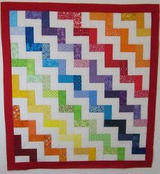 Use this rainbow quilt pattern to make simple baby quilts or kids' quilts.
