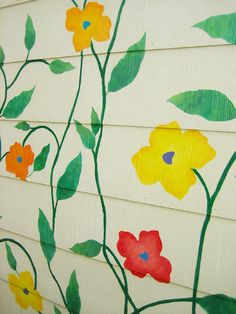 Color blooms on the corrugated wall...mural-style!