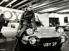 February London, British model Twiggy wearing style maxi coat and spotted headscarf takes delivery of her new Toyota 2000 GT sports car Get premium, high resolution news photos at Getty Images Vintage Posters, Vintage Photos, Toyota 2000gt, Engin, Best Classic Cars, Toyota Cars, Top Cars, History Photos, Sale Poster