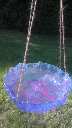 Home made bird bath made by melting plastic beads
