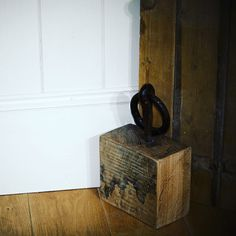 Solid oak doorstop made from reclaimed timber that was...