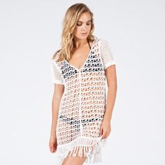 8dce6a13e88 This open crochet pattern and deep V neckline are simple feminine. Also  features a knitted sleeves and fringe detail at hem.