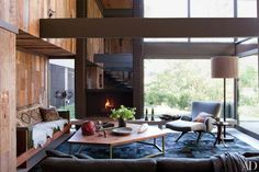 Reclaimed-oak paneling gives the double-height living room of a Commune-designed house in Los Angeles a rustic air.