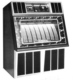 """1982, Rowe-AMI's Model R-86 Blue Magic: """"Crystalline blue metallic coloring. Bubbling mirrors, reflecting 40 white and blue lights over and over to create a galaxy of stars in spellbinding geometric patterns."""" [Jukebox Collector]"""
