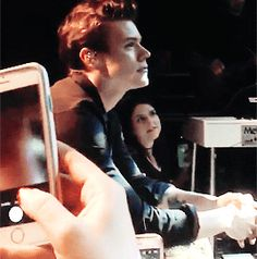Harry joining the audience to watch Stevie Nicks on stage.