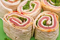 Ham & Cheese pinwheels  Let your kids do the dirty work with this one. Spread a tortilla with softened low-fat cream cheese, then layer deli ham to cover the whole circle. Let your kids roll them up, and refrigerate. Once they're chilled, help them cut the logs into 1 inch sections. Lay the wheels on their sides and you've got a great set of finger foods.