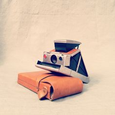Dr. Lands iconic SX-70 Polaroid SLR folding camera. Remarkable in its day.
