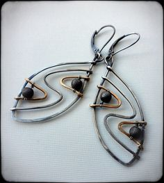 Idea for w wire wrap pendant but these are earrings by Silver and gold-filled earrings by anikosandor, via Flickr