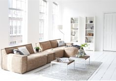 This is a modular sofa from troubadour.nl Style suggestion, will look very striking in petrol blue leather