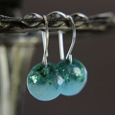 tiny green earrings with blue green flakes and by tinygalaxies, $16.00