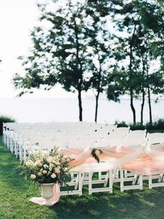 Pink tulle draped white ceremony chairs: http://www.stylemepretty.com/maryland-weddings/stevensville-maryland/2015/11/20/classic-romantic-wedding-at-the-chesapeake-bay-beach-club/ | Photography: Krista A Jones - http://kristaajones.com/