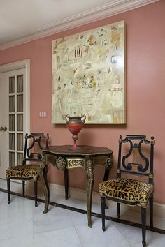 Love the wallcolor, the painting, and the animal print fabric.