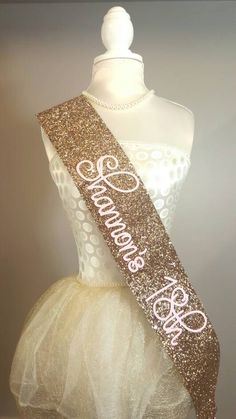 Beautiful handmade gold glitter Birthday Goddess sash. Gold Birthday sash comes with baby pink text. There are colour choices for this product; gold, silver, black and pink Please have a look at out other listings for colours. This product can be personalised - have a look at our shop listings. Please note - These are handmade made from a heavy glitter material and may vary in shape/ size. DELIVERY SCHEDULE The following postage times are in addition to manufacturing times. - UK orde...