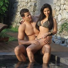 Kim Kardashian and Kris Humphries with black and gold number bikinis