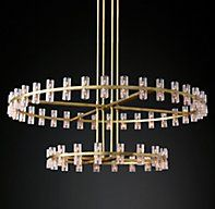 """RH Modern's Arcachon Round Chandelier 60"""":Jonathan Browning's rhythmic design for the Arcachon collection is inspired by the shape and scale of industrial gears, where spokes intersperse with negative space in order to interlock with other gears. Here, the spokes are hexagonal forms juxtaposed with rounded interiors, beautifully crafted of crystal, running along a simple, solid brass frame.SHOP THE ENTIRE COLLECTION ▸"""