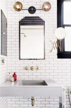 bathroom with white subway tile and brass hardware