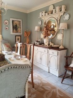 Fascinating use of vintage dresser mirror turned upside down with shelf on top. Sherwin Williams oyster bay in cottage dining room #shabbychicdresserswithmirror #shabbychicdressersvintage